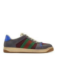 Baskets basses à rayures horizontales gris foncé Gucci