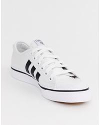 Baskets basses blanches et noires adidas Originals
