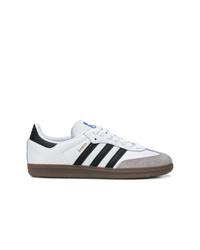 Baskets basses en cuir blanches et noires adidas