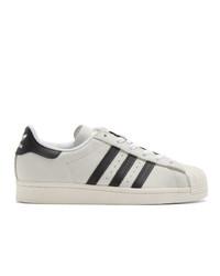 Baskets basses en cuir blanches et noires adidas Originals