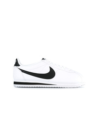 Baskets basses en cuir blanches et noires Nike