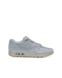 Baskets basses en cuir grises Nike