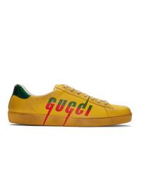 Baskets basses en cuir imprimées jaunes Gucci