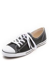 Baskets basses en cuir noires et blanches
