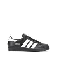 Baskets basses en cuir noires et blanches adidas