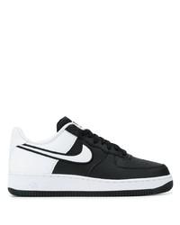 Baskets basses en cuir noires et blanches Nike