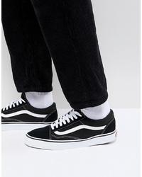 Baskets basses en daim noires et blanches Vans