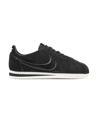 Baskets basses en daim noires Nike