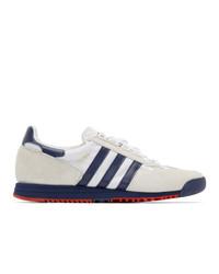 Baskets basses en toile blanc et bleu marine adidas Originals