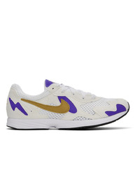 Baskets basses en toile blanches Nike