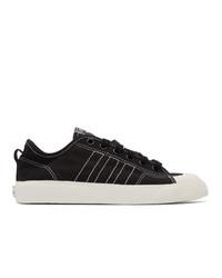 Baskets basses en toile noires et blanches adidas Originals