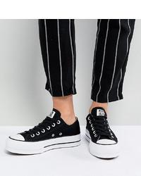 Baskets basses en toile noires et blanches Converse
