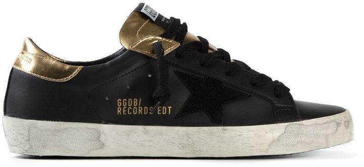 économiser b6cb4 2547f Baskets basses noir et doré SuperStar