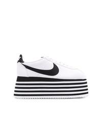 Baskets compensées en cuir blanches et noires Nike