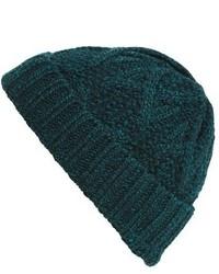 Bonnet en tricot vert foncé