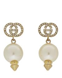 Boucles d'oreilles dorées Gucci