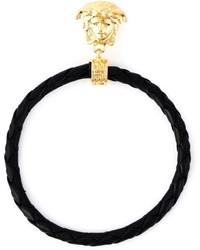 Boucles d'oreilles noir et doré Versace