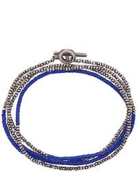 Bracelet orné de perles bleu marine M. Cohen