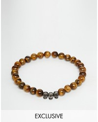 Bracelet orné de perles tabac Simon Carter