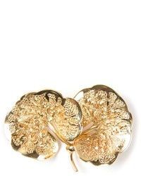 Broche dorée Christian Dior