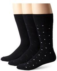 Chaussettes á pois noires et blanches