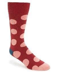 Chaussettes á pois rouges