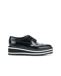 Chaussures brogues en cuir noires Prada