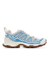 Chaussures de sport blanc et bleu Salomon