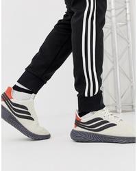 Chaussures de sport blanches et noires adidas Originals
