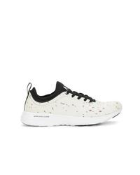 Chaussures de sport blanches et noires Apl