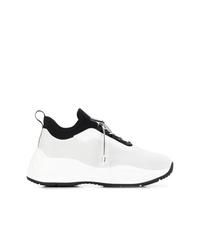 Chaussures de sport blanches et noires Prada