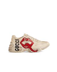 Chaussures de sport dorées Gucci