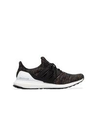 Chaussures de sport noires et blanches adidas