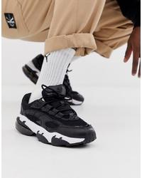 Chaussures de sport noires et blanches Puma