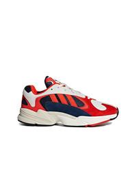 Chaussures de sport rouge et blanc adidas