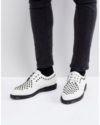 Chaussures derby en cuir blanches Dr. Martens
