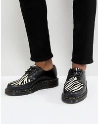 Chaussures derby en cuir noires et blanches Dr. Martens