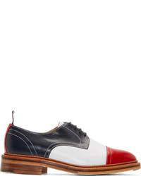Chaussures derby en cuir noires et blanches Thom Browne