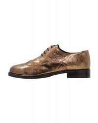 Chaussures richelieu dorées Minelli