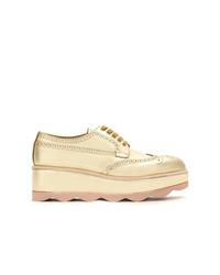 Chaussures richelieu en cuir dorées Prada