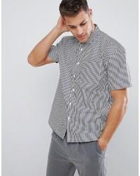 Chemise à manches courtes à rayures verticales blanche et noire