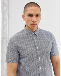 Chemise à manches courtes à rayures verticales bleu marine Lacoste
