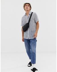 Chemise à manches courtes imprimée blanc et bleu ASOS DESIGN