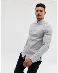 Chemise à manches longues à rayures verticales bleu clair Armani Exchange