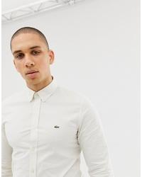 Chemise à manches longues blanche Lacoste