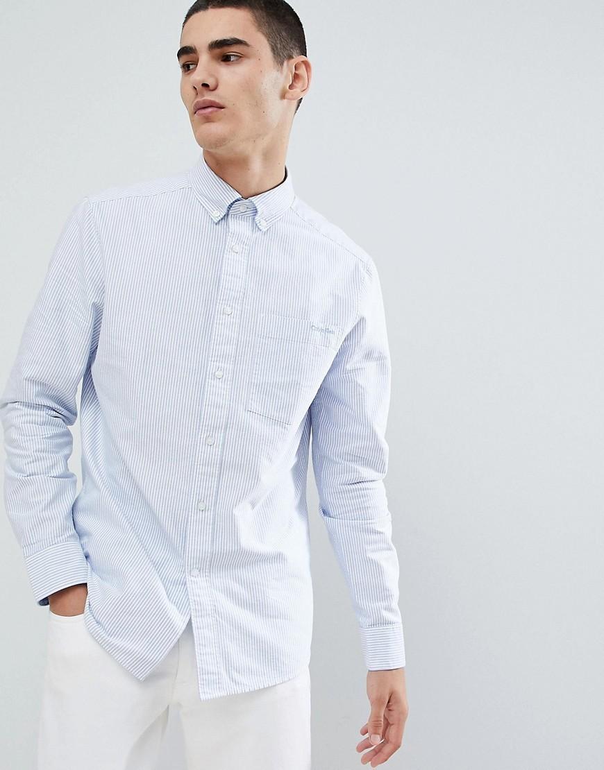 Chemise de ville à rayures verticales bleu clair Calvin Klein