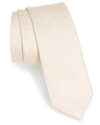 Cravate à carreaux beige