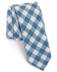 Cravate à carreaux bleu clair