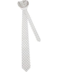 Cravate á pois blanche et noire