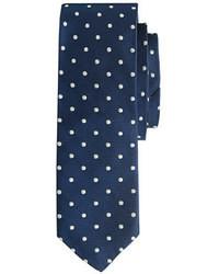 Cravate á pois bleu marine et blanc